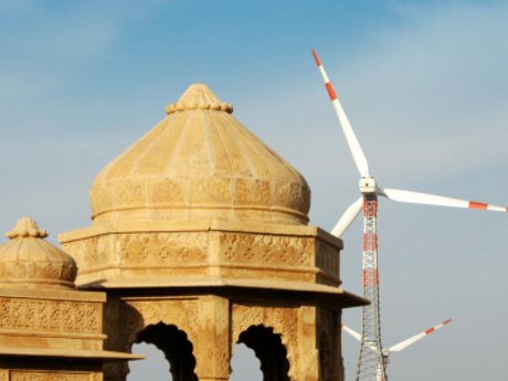 Wind turbines behind an Indian temple